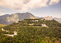 Aerial view of a winding road leading up to Catholic church Santuario Santissimo Salvatore, in the mountains of Avellino, Campania, Italy