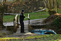 © Licensed to London News Pictures. 23/11/2012. Chew Stoke, UK.  Police examine the vehicle where a man died last night when his vehicle got swept off a ford down a river and got stuck under a bridge in Chew Stoke in Somerset.  The vehicle was recovered this afternoon with a JCB.  23 November 2012..Photo credit : Simon Chapman/LNP