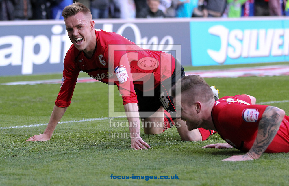 Picture by Mike  Griffiths/Focus Images Ltd +44 7766 223933.27/04/2013.Craig Noone (L) of Cardiff City celebrates his goal against Bolton Wanderers during the npower Championship match at the Cardiff City Stadium, Cardiff.