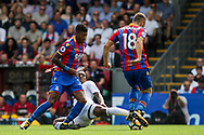 Leroy Fer of Swansea city gets a toe to the ball to stop Patrick Van Aanholt and James Mcarthur of Crystal Palace (r). <br /> Premier League match, Crystal Palace v Swansea city at Selhurst Park in London on Saturday 26th August 2017.<br /> pic by Kieran Clarke, Andrew Orchard sports photography.