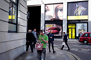 A pair of eyes and passers-by on Fenchurch Street - in the heart of the capital's financial district (aka The Square Mile), on 24th September 2018, in London, England.