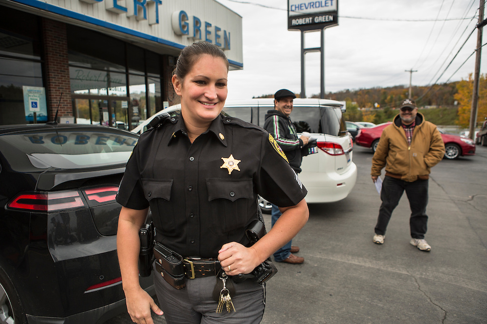 Sergeant Crumley smiles while walking away after she jokes with two men who accidentally tripped an alarm at the local car dealership while looking at vehicles. While investigating the call, a local teacher happened to be in the area and described Cheryl as one of Sullivan County's finest, also serving as a School Resource Officer for the local elementary school.