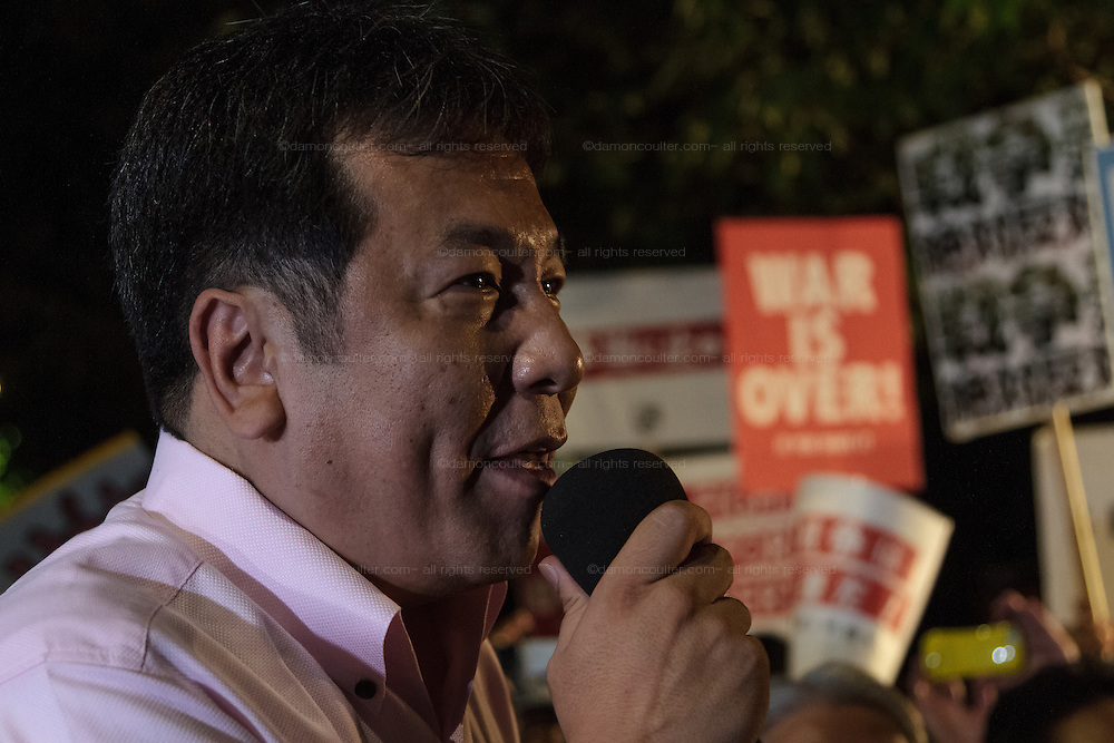 Yukio Edano, a former Chief Cabinet Secretary with the DPJ (Democratic Party Of Japan) speaks at a demo outside the Japanese parliament building against Prime Minister, Shinzo Abe and his reinterpretation of Article 9 of the Japanese Constitution. Nagatacho, Tokyo, Japan. Friday July 17th 2015. Around 10,000 people took part to protest a change in the law that would allow collective self-defence which was ratified in the Lower House on Thursday. Many fear this new interpretation of Japan's unique peace constitution will mean Japanese soldiers being sent to war, to aid allies such as America,