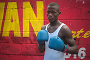 Guanuma, Santo Domingo North - Documented cases of descendants of haitian migrants, born in the Dominican Republic, that do not have access to passport nor documents and are facing deportation. Adonis Peguero Louis loves boxing but he can not improve his technique because he can not compete, as he needs documents to participate on boxing events. Editorial and Commercial Photographer based in Valencia, Spain |Portraits, Hospitality, News, Sports, Media Coverage for Events