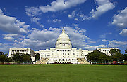 United States Capitol against blue sky with green grass