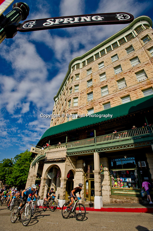 Stock photography of a bikers riding past the Basin Park Hotel before the Fat Tire Festival in downtown Eureka Springs, Arkansas.