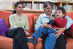 Family sitting on the sofa,