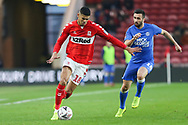Middlesbrough forward Ashley Fletcher (18) plays the ball under pressure from Peterborough United defender Danny Lafferty (18) during The FA Cup 3rd round match between Middlesbrough and Peterborough United at the Riverside Stadium, Middlesbrough, England on 5 January 2019.