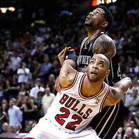 29 January 2012: Chicago Bulls forward Taj Gibson (22) vies for the rebound with Miami Heat power forward Udonis Haslem (40) during the Miami Heat 97-93 victory over the Chicago Bulls at the AmericanAirlines Arena, Miami, Florida, USA.