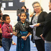 To'Hajiilee Community School third graders Nehemiah Platero, left, Nailynn Manning, center, and fifth grade teacher Patricia Serna-Ahlen, right, participate in a Q and A with U.S. Representative Deb Haaland during her visit to To'Hajillee Community School Tuesday, Oct. 8 in To'Hajiilee.