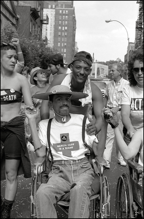 Julie Tolentino, Patricia Navarro, David Robinson, Ray Navarro, Herman Robinson, Roma Baran and others members of ACTUP march in the Gay Pride Parade in New York City in June, 1990. <br /> <br /> Ray Navarro was an American video artist, filmmaker, and HIV/AIDS activist. Navarro was an active member of ACT UP and a founder of Diva TV. His activism was featured in the documentary How to Survive a Plague. Navarro's art was exhibited at the Institute of Contemporary Art, Boston, and in Pacific Standard Time: LA/LA. Ray Navarro died in November of 1990.