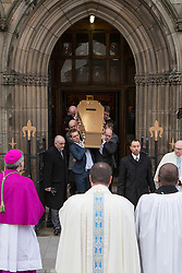 © Licensed to London News Pictures . 16/01/2014 . Salford , UK . The coffin is lead from the cathedral after the service . The funeral of Labour MP Paul Goggins at Salford Cathedral today (Thursday 16th January 2014) . The MP for Wythenshawe and Sale East died aged 60 on 7th January 2014 after collapsing whilst out running on 30th December 2013 . Photo credit : Joel Goodman/LNP