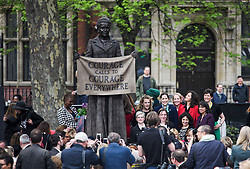 © Licensed to London News Pictures. 24/04/2018. London, UK. MPs and members of the the public gather around the stature at the end of a ceremony for the unveiling of a statue of Millicent Fawcett in Parliament Square, London. Dame Millicent, a leading Suffragist and campaigner for equal rights for women, is the first woman to be commemorated with a statue in Parliament Square. Photo credit: Ben Cawthra/LNP