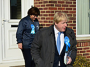 © Licensed to London News Pictures. 20/02/2013. Eastleigh, UK Boris Johnson and Maria Hutchins canvas a property. London Mayor and member of the Conservative Party, Boris Johnson, and Conservative Candidate Maria Hutchins campaigning in the Eastleigh By-Election today 20th February in Stamford way, Eastleigh. Photo credit : Stephen Simpson/LNP
