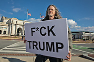 Biden supporter with a sign indicating his dislike for Trump in Washington DC during Biden's inuguration.