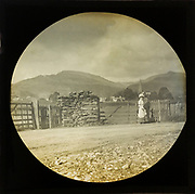 Woman Victorian or Edwardian tourist with background of Ambleside, Lake District, Cumbria, England, UK c 1900