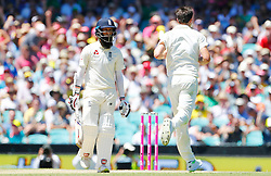 England's Moeen Ali is dismissed by Pat Cummins during day two of the Ashes Test match at Sydney Cricket Ground.