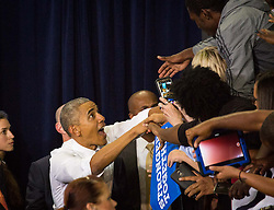 October 28, 2016 - Florida, U.S. - LOREN ELLIOTT   |   Times .President Obama greets fans after speaking at a Hillary Clinton campaign rally at the University of Central Florida in Orlando on Friday, Oct. 28, 2016. He encouraged voters to cast their ballots early. (Credit Image: © Loren Elliott/Tampa Bay Times via ZUMA Wire)