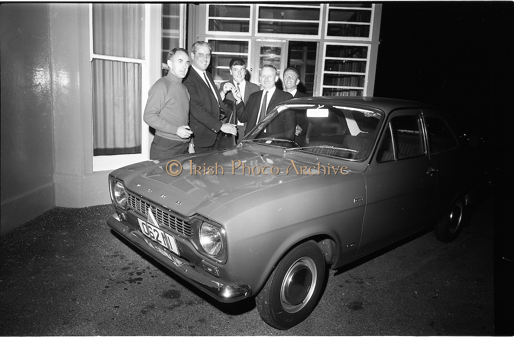 16/09/1968<br /> 09/16/1968<br /> 16 September 1968<br /> CBSI draw for street car at the Claremont Hotel, Sutton Dublin.Draw for a Ford Escort in aid of the building fund of the 87th Dublin (Baldoyle) Troop of the Catholic Boy Scouts of Ireland made by Bunny Carr, Tv personality. Picture shows Mr Healy  (3rd from left) Sales Manager, Abbey Service Garage, Wicklow, presenting the car to Mr Pat Singleton (winner), with (from left) Donal O'Leary, PRO 87th Dublin Troop CBSI; Mr Frank Lawlor, Abbey Service Station and Mr Martin Heffernan, Chairman, 87th Dublin Troop Parents Committee.
