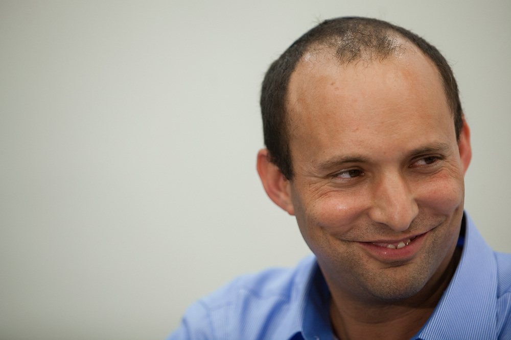 Naftali Bennett smiles during a press conference at the Knesset, Israel's parliament in Jerusalem, on May 22, 2012. Israeli parliament member Uri Orbach (not pictured) of the Jewish Home party has announced today his support for Bennett as the next head of the party.