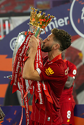 LIVERPOOL, ENGLAND - Wednesday, July 22, 2020: Liverpool's Adam Lallana kisses the Premier League trophy as his side are crowned Champions after the FA Premier League match between Liverpool FC and Chelsea FC at Anfield. The game was played behind closed doors due to the UK government's social distancing laws during the Coronavirus COVID-19 Pandemic. Liverpool won 5-3. (Pic by David Rawcliffe/Propaganda)