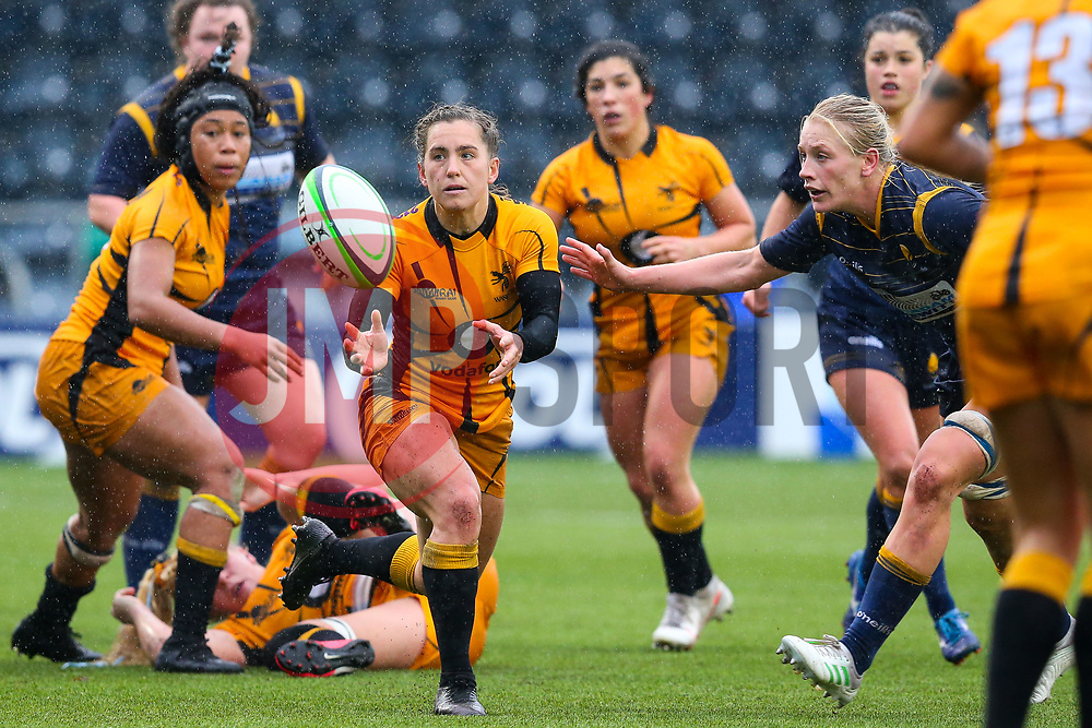 Claudia MacDonald of Wasps FC Ladies fires a pass, watched by Alex Matthews of Worcester Warriors Women - Mandatory by-line: Nick Browning/JMP - 24/10/2020 - RUGBY - Sixways Stadium - Worcester, England - Worcester Warriors Women v Wasps FC Ladies - Allianz Premier 15s