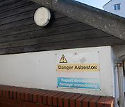 Sign warning of asbestos roof danger, UK