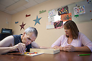 David Shunkey works doing a series of exercises designed to help in with packing his products and run his business with help from Heather Gooch, Program Manager for Support Employment at Community Options Inc. in Albuquerque NM on Wednesday morning, July 14, 2010...Credit:Steven St. John for The Wall Street Journal.SMBIZ DISABLED.