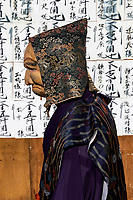 Jiji Elderly Man at Mengake Kamakura - Mengake or Masked Parade at Goryo Jinja shrine.  At this festival held in September a group of ten people take part in this annual ritual: 8 men and 2 women. Wearing comical or grotesque masks that signify different demons, legends and dieties  leave the shrine and parade through the nearby streets accompanied by portable shrine and festival music.