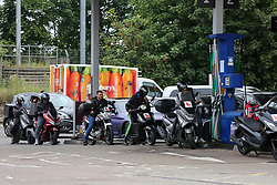 © Licensed to London News Pictures. 25/09/2021. London, UK. Uber delivery drivers wait at a petrol pump at Sainsbury's petrol station in north London as drivers continue to panic buy petrol amid a fuel shortage fear arising from a shortage of HGV drivers. Photo credit: Dinendra Haria/LNP