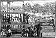 De Kaap goldfields, Transvaal, South Africa. Water-powered stamping mill for crushing gold-bearing quartz ore, Moodie's Farms, near Brereton.  Engraving from 'The Illustrated London News', 1887.