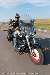 Ed Rieken (Subject of Early Morning) and Jaxon ride in the annual Lichter/Sugar Bear Ride during the 75th Annual Sturgis Black Hills Motorcycle Rally.  SD, USA.  August 5, 2015.  Photography ©2015 Michael Lichter.