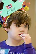 Nederland, Veghel, 20101117.?Jongen van 4 is jarig en viert zijn verjaardag op de creche. Hij heeft een verjaardagsmuts op met hun naam en leeftijd. Close-up?Kinderopvang 't Kroontje in Veghel...Netherlands, Veghel, 20101117. ?Boy of 4 celebrates hisbirthday at the nursery. He wears a birthday hat with hisname and age on it. ?Childcare t Kroontje in Veghel..