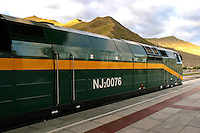Engine of the Tibet Train - The Qinghai-Tibet Railway, the highest rail line in the world, is usually called the Tibet Train.  Its 1,200 miles of tracks traverse 342 miles of permafrost, lots of it at altitudes exceeding 12,000 feet. The end of the line is Lhasa, Tibet. Proponents of the new railway say it will bring economic development to the Tibet and China's hinterlands as Tibet and China's far west lag behind the rest of the country, and rail connectivity promises to be a crucial tool for closing that gap.  Critics say the railway is  a political tool to strategically stitch Tibet into the fabric of China and facilitate the westward migration of ethnic Chinese.  The only thing about the train that everyone agrees on,  the the Tibet  train is an engineering marvel.