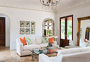 Freshly renovated Spanish Villa style living area in a historic Texas home.
