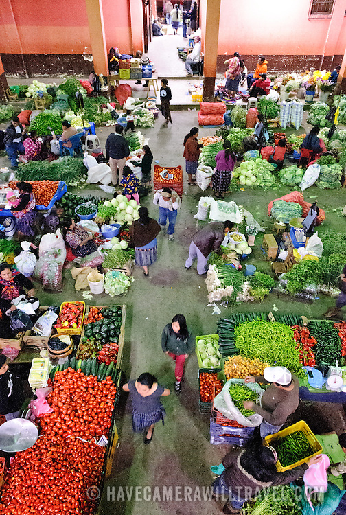 Fresh fruit and vegetables for sale in Chichicastengo's gymnasium as part of the famous Sunday market. Chichicastenango is an indigenous Maya town in the Guatemalan highlands about 90 miles northwest of Guatemala City and at an elevation of nearly 6,500 feet. It is most famous for its markets on Sundays and Thursdays.