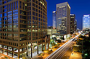 Long exposure photo of the a city street in downtown Phoenix, Arizona at night.