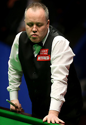 John Higgins reacts during day seventeen of the Betfred Snooker World Championships at the Crucible Theatre, Sheffield.