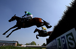 Gun Shy ridden by jockey Jamie Moore and Under The Phone ridden by Jockey Charlie Poste (right) during the Qatar Airways Handicap Chase during Kids Carnival Day of The Qatar Airways May Racing Carnival at Warwick Racecourse.