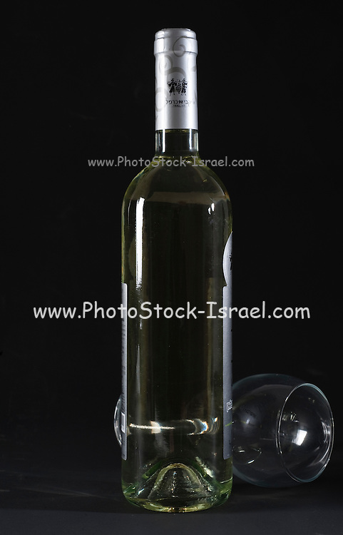 a bottle and glass of Israeli white wine