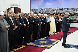 June 15, 2018 - Ramallah, West Bank, Palestinian Territory - Palestinian President Mahmoud Abbas and his Prime Minister Rami Hamdallah perform Eid al-Fitr prayer in the West Bank city of Ramallah on June 15, 2018. Muslims worldwide celebrate Eid al-Fitr marking the end of the fasting month of Ramadan  (Credit Image: © Thaer Ganaim/APA Images via ZUMA Wire)