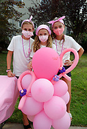 Merrick, New York, U.S. August 15, 2020. Tweens, L-R, MADDY, ANNIE FITZPATRICK, and ISABELLE, wearing pink and face masks, pose by pink balloons after hours of selling shells they and friends painted, to raise funds to donate to American Cancer Society Making Strides Against Breast Cancer. The trio formed Lizzie's Army after Annie's 24-year-old sister Lizzie Fitzpatrick was diagnosed with Triple Negative Breast Cancer in late June. Over $3,000 has been raised so far through shell sales and GoFundMe.