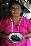 Eugenia Sho, 48, cacao grower from San Antonio, displays a spicy cacao paste used for a locally-consumed cold cacao drink. Toledo Cacao Growers' Association (TCGA), San Antonio, Toledo, Belize. January 28, 2013.