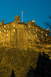Pictured: Edinburgh Castle from the Grassmarket<br /> <br /> A view less often seen of Edinburgh Castle; which has never been over taken; with the Uniion flag blowing in the winter sun<br /> <br /> Ger Harley | EEm 28 January 2019