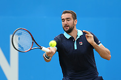 Croatia's Marin Cilic in action against USA's Donald Young during day five of the 2017 AEGON Championships at The Queen's Club, London.