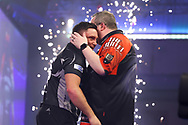 Stephen Bunting congratulates Gerwyn Price for winning the match during the William Hill World Darts Championship Semi-Finals at Alexandra Palace, London, United Kingdom on 2 January 2021.