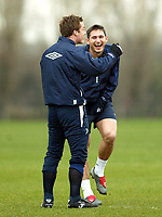 Photo: Scott Heavey.<br /> Chelsea Training session. 23/03/2004.<br /> Frank Lampard enjoys a joke with Scott Parker