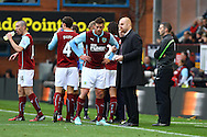 Burnley players take instructions from Burnley Manager Sean Dyce during a break in play. Barclays Premier league match, Burnley v Everton at Turf Moor in Burnley, Lancs on Sunday 26th October 2014.<br /> pic by Chris Stading, Andrew Orchard sports photography.
