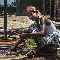 A worker makes bamboo mats near Dhaka, Bangladesh.
