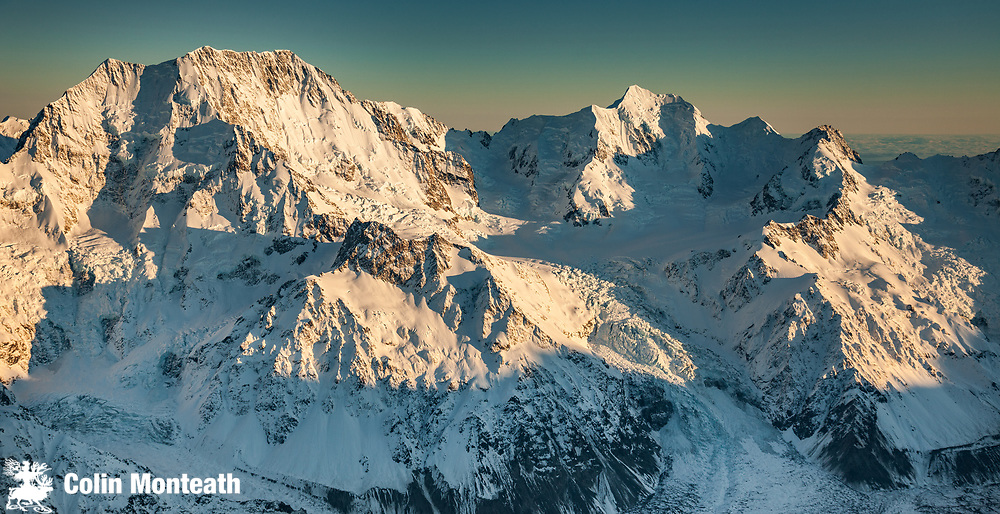 Aoraki  Mount Cook (left) and Mt Tasman, two highest peaks in Southern Alps, eastern aspects in winter, aerial view from over Liebig Range, Aoraki  Mount Cook National Park, Canterbury